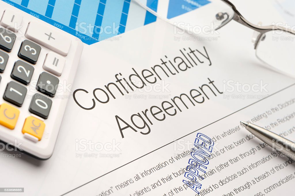 Approved confidentiality agreement form on a desk stock photo