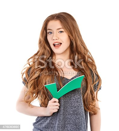istock approved cute teenager with sign 476083692