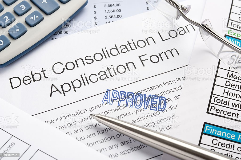 Approved Debt Consolidation Loan Application Form with pen, calc royalty-free stock photo