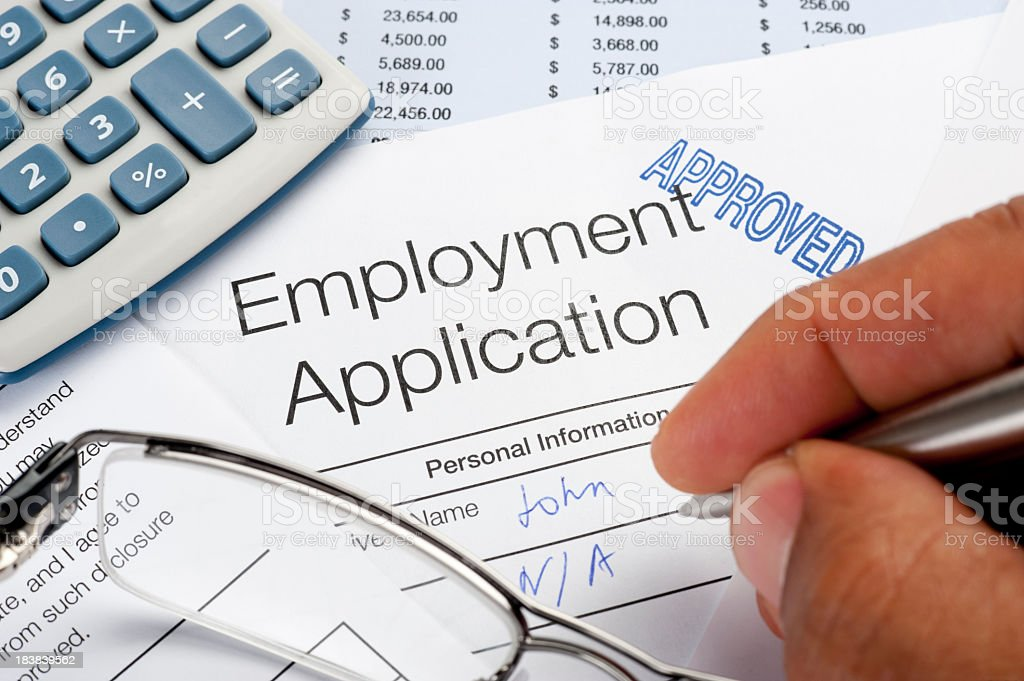 Approved Employment application Form with pen, calculator, handw royalty-free stock photo