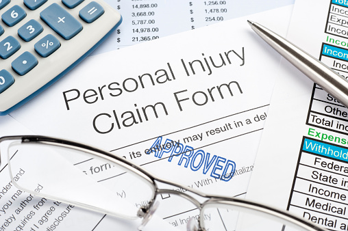 istock Approved Personal Injury Claim Form 183584289