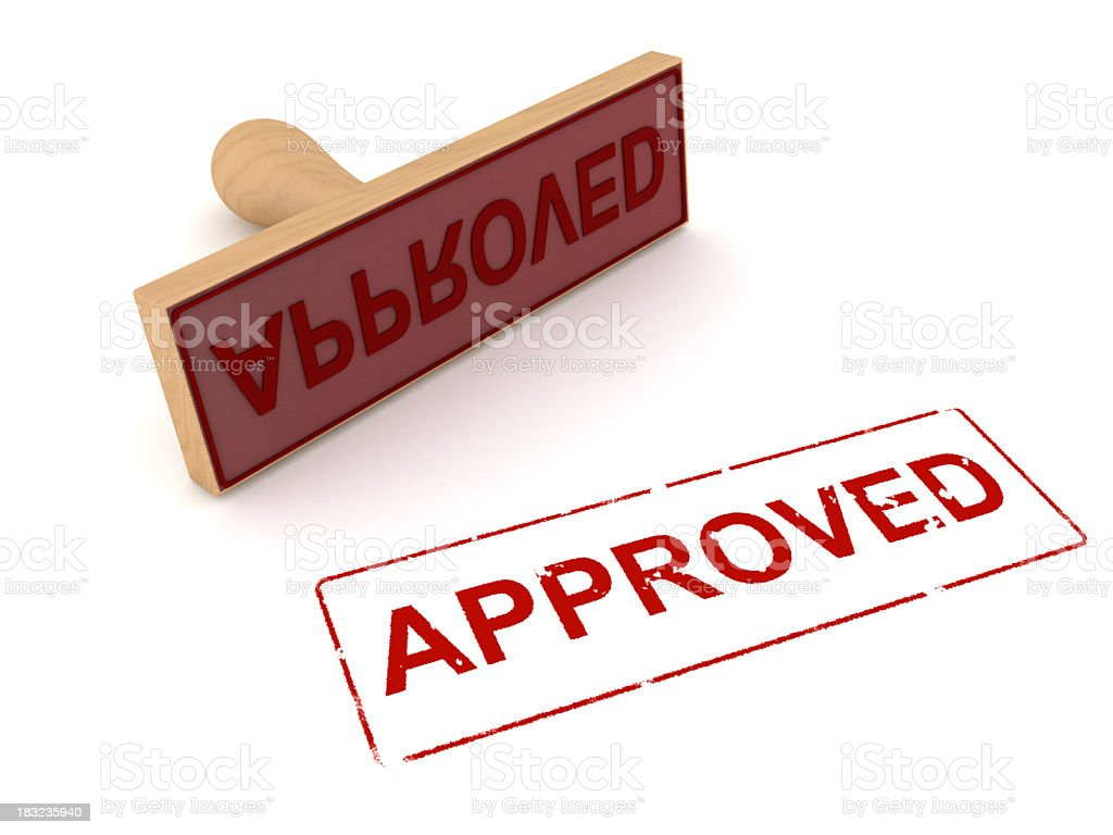 Approved rubber stamp with wooden handle with red ink  stock photo