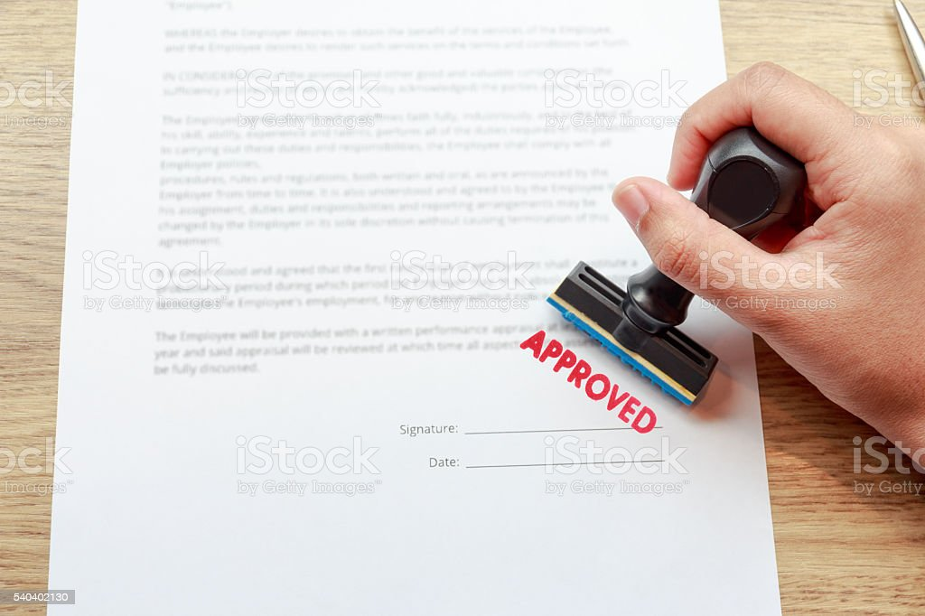 Approved the contract documents with rubber stamp stock photo