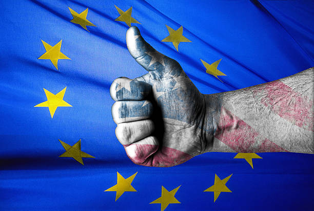 USA approves EU actions USA approves EU actions concept with thumbs up and the flags of EU and USA american flag tattoos for men stock pictures, royalty-free photos & images