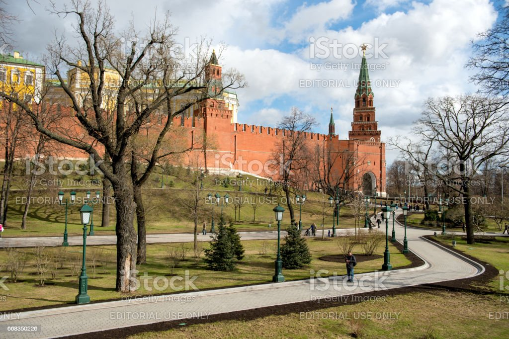 Apr 17, 2015 - Moscow, Russia : tourist on the walkway with Walls and Towers of the Kremlin stock photo