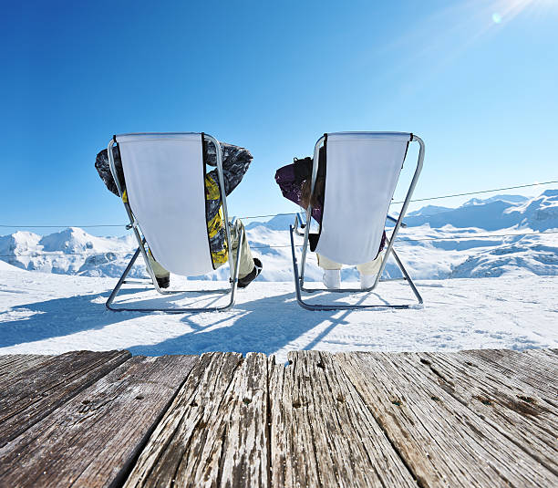 Apres ski at mountains Couple at mountains in winter, Val-d'Isere, Alps, France apres ski stock pictures, royalty-free photos & images