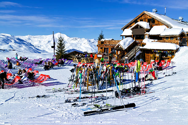 Apres ski in a chalet bar in Alps Val Thorens, Alps, France, February 09 2015: People are relaxing at a chalet bar after skiing and snowboarding in in the 3 Valleys Ski Resort apres ski stock pictures, royalty-free photos & images
