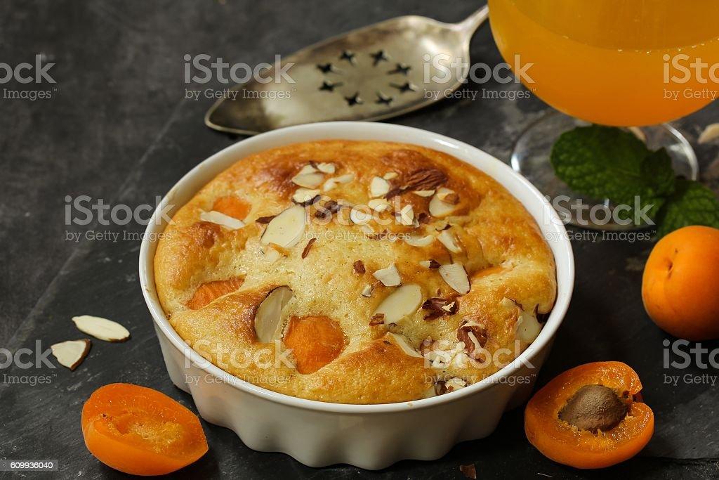 Apricot cake / Apricot pudding cake with fresh apricots stock photo