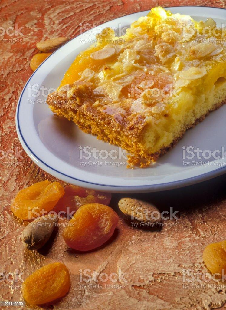 Apricot cake  on a orange background. stock photo