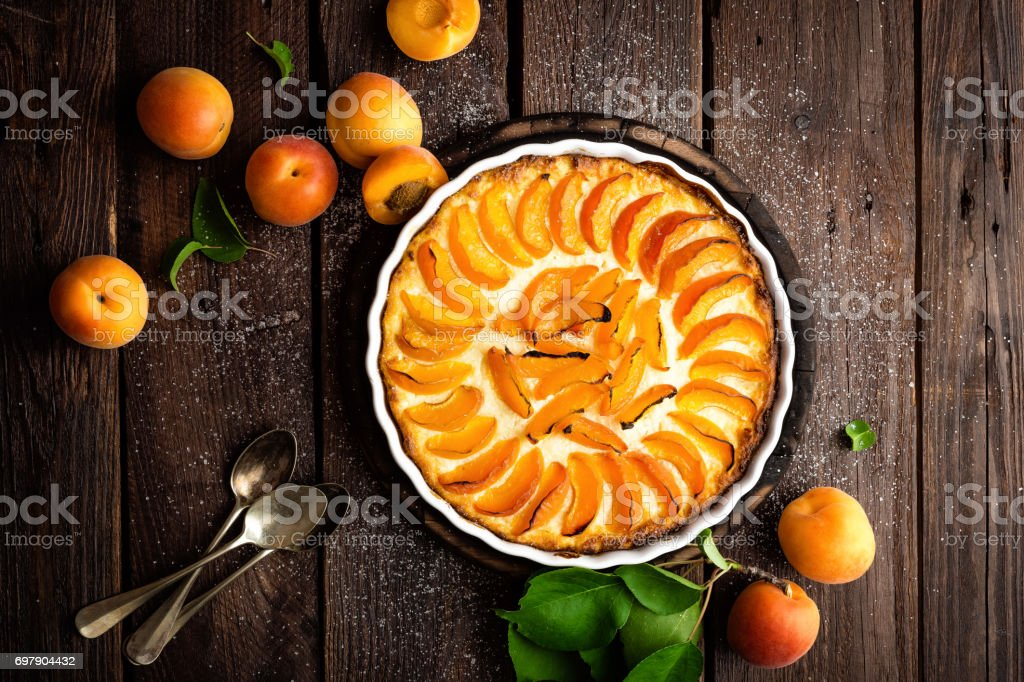 Apricot cake or pie with fresh fruits, cheesecake stock photo