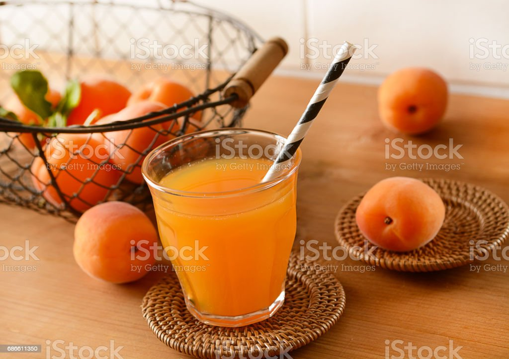 Apricot juice in the glass with fruit around - closeup royalty-free stock photo