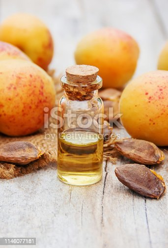 apricot oil in a small jar. selective focus. nature.