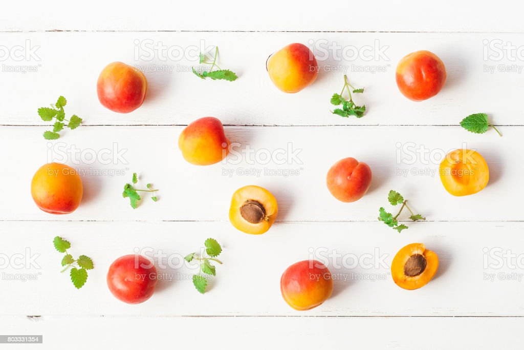 Apricot on white wooden background. Top view, flat lay stock photo