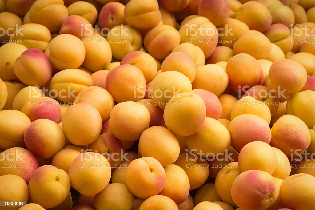apricot peaches - pile of fruits stock photo
