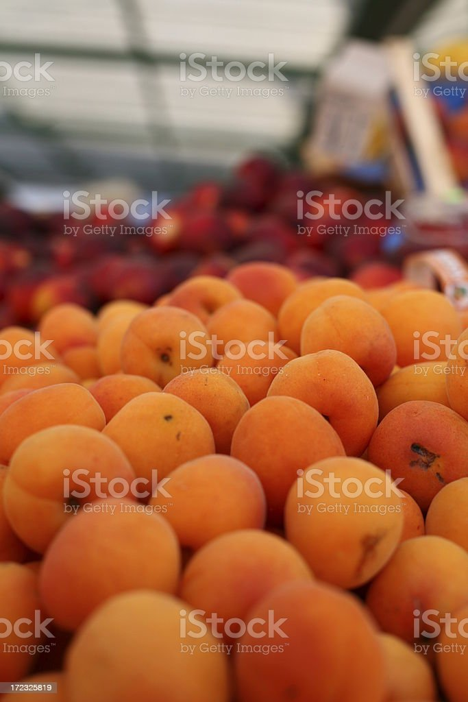 Apricots and nectarines at a farmers market royalty-free stock photo