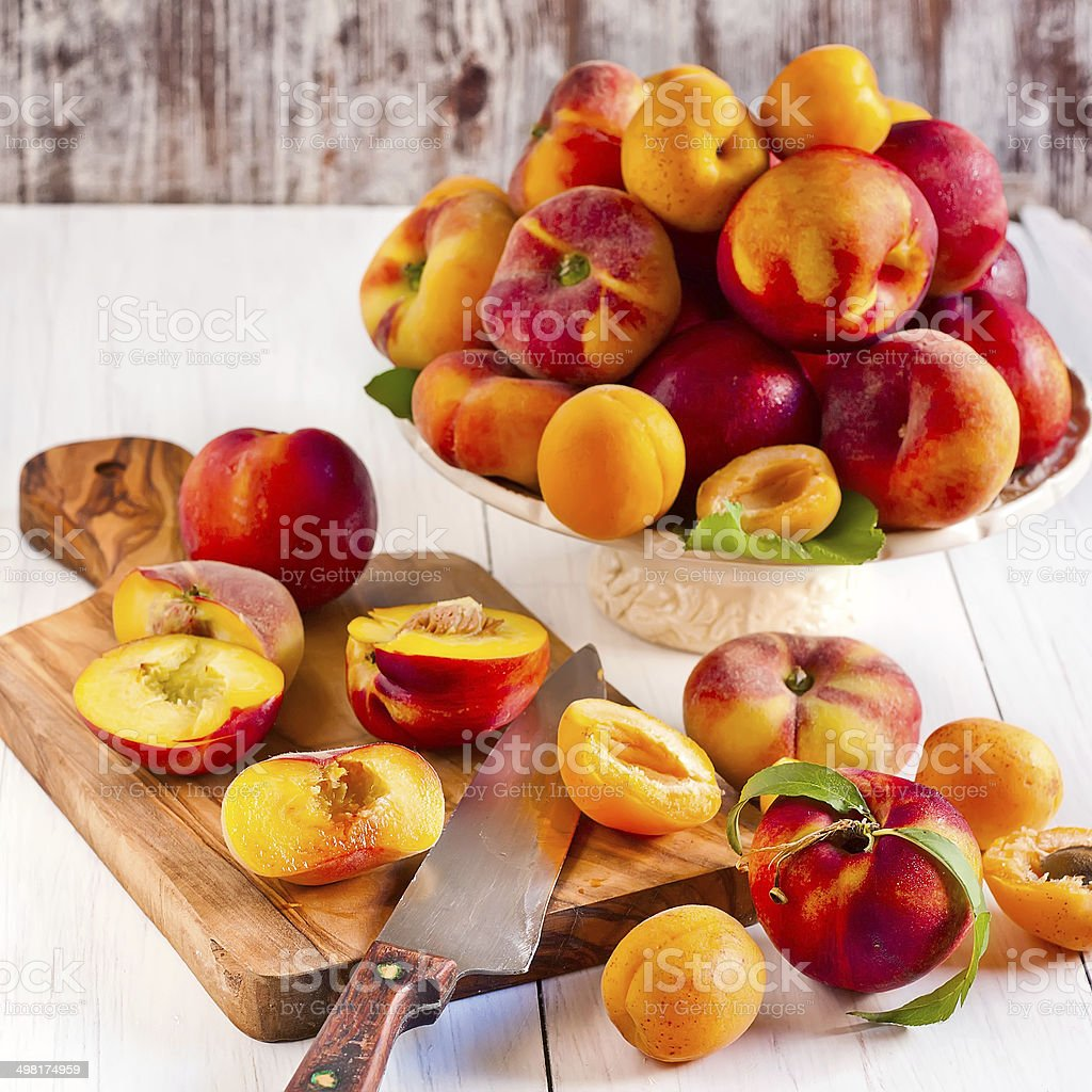 Apricots, nectarines and saturn peaches stock photo
