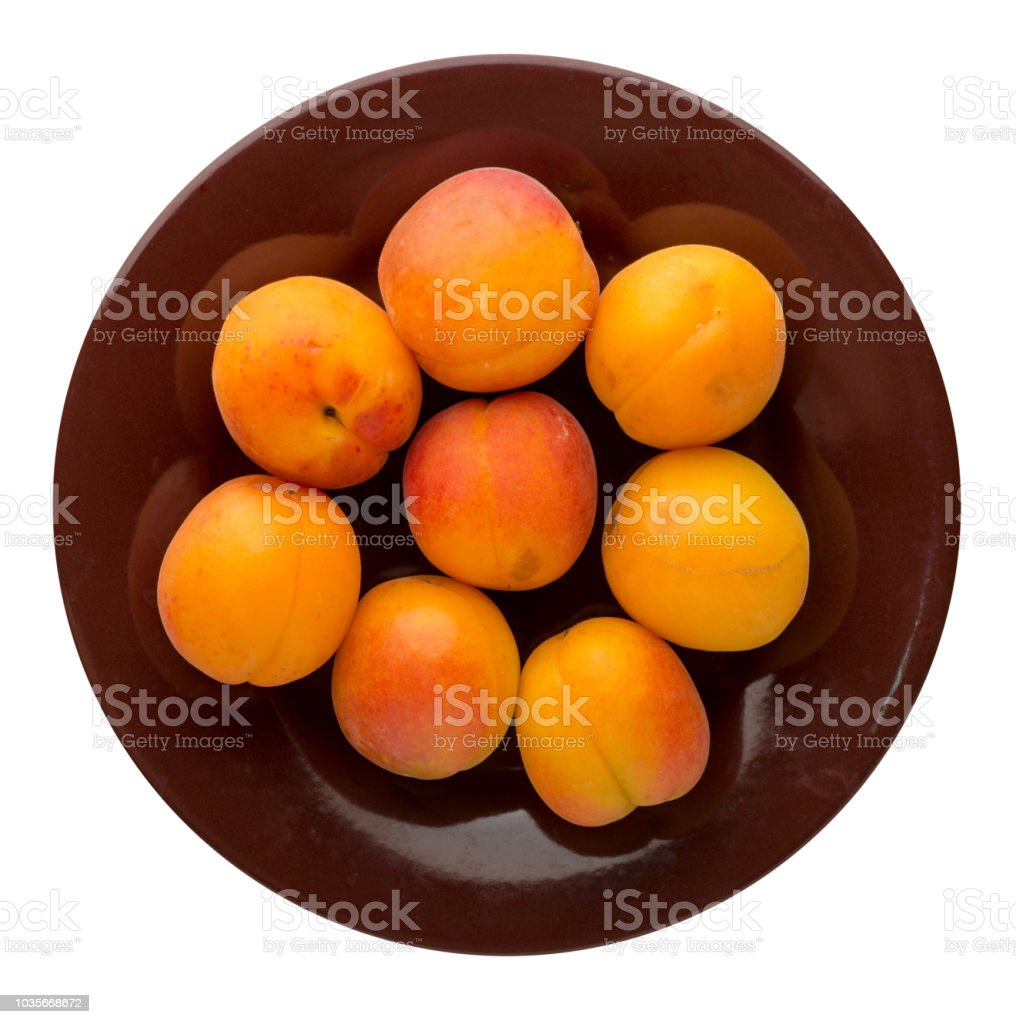 apricots on a plate isolated on a bacground background. stock photo