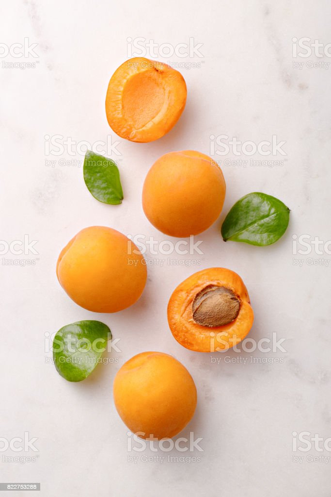 Apricots on marble background viewed from above. Fresh and healthy fruit. Top view stock photo