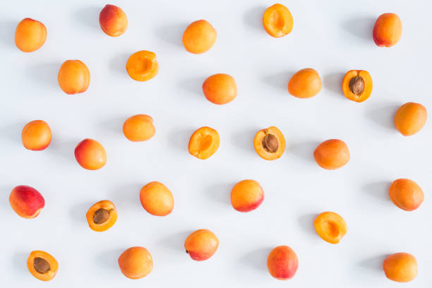 Apricots on pastel blue background. Flat lay, top view stock photo