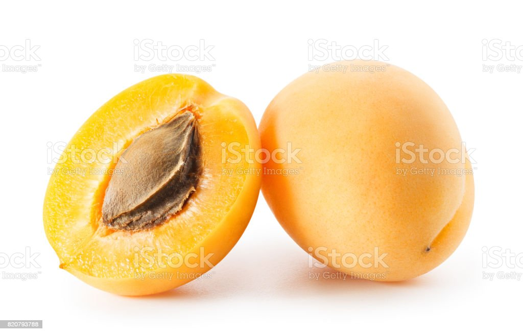 Apricots or peaches isolated on white background stock photo