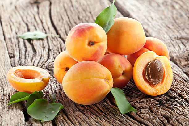 Apricots with leaves. stock photo