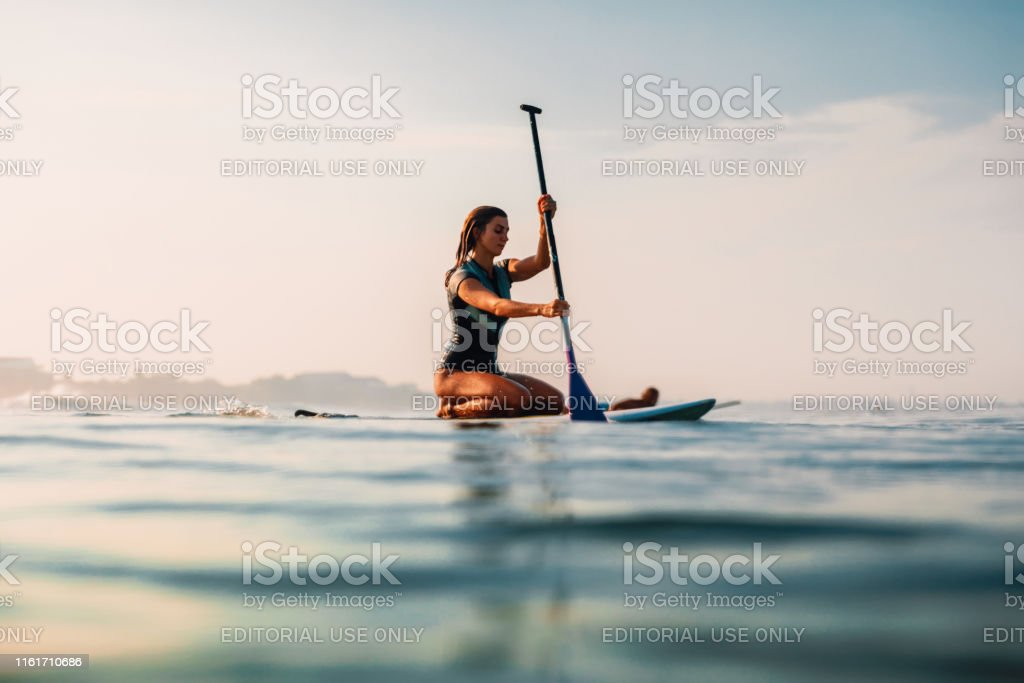 April 12, 2019. Bali, Indonesia. Stand Up Paddle surf girl in ocean....