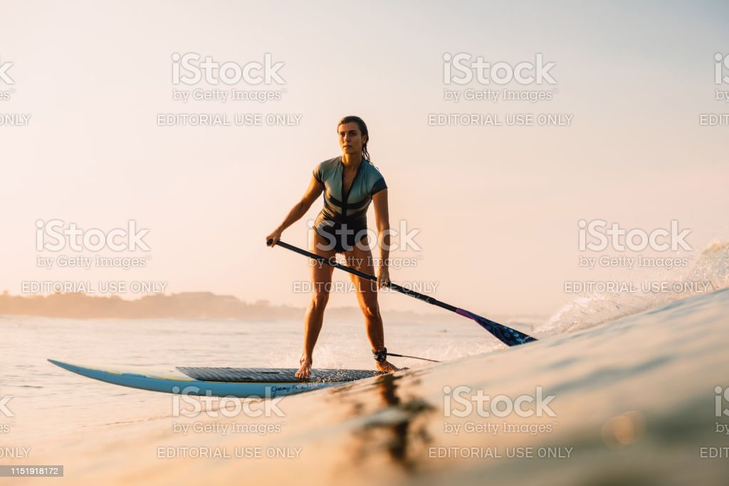 April 12, 2019. Bali, Indonesia. Stand Up Paddle surfer ride on ocean...