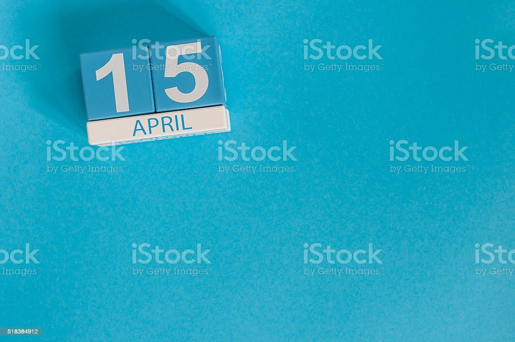 April 15th. Tax Day. Image of april 15 wooden color stock photo