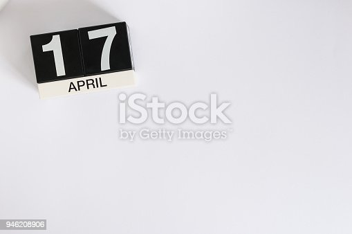 April 17th. Image of april 17 wooden color calendar on white background.  Spring day, empty space for text. Tax Deadline.
