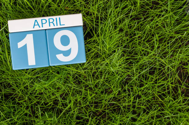 april 19th. day 19 of month, calendar with football green grass background. spring time - number 19 stock photos and pictures