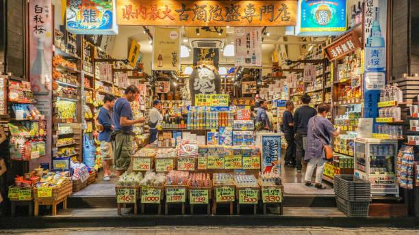 OKINAWA, JAPAN - April 20 , 2017:  Kokusai dori, the main street at night in Naha City, Okinawa, Japan . OKINAWA, JAPAN - April 20 , 2017:  Kokusai dori, the main street at night in Naha City, Okinawa, Japan . kokusai dori okinawa stock pictures, royalty-free photos & images