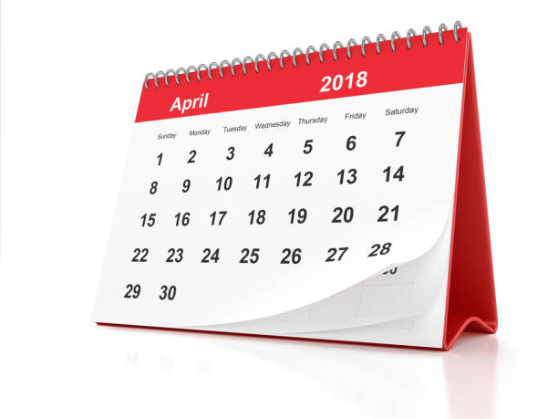 April 2018 Desktop Calendar with Red Plastic on White Background stock photo