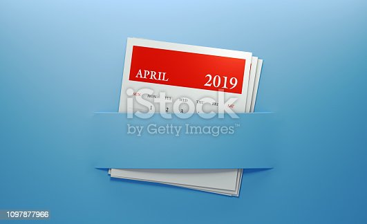 1124594277istockphoto April 2019 Calendar Inserted Into Blue Background 1097877966