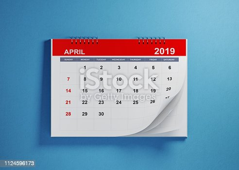 1124594277 istock photo April 2019 Calendar On Blue Background 1124596173