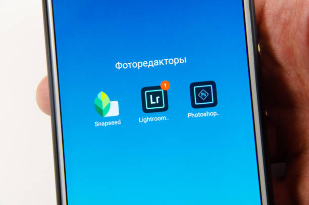 April, 2019. Kramatorsk, Ukraine. Mobile application Lightroom mobile on a white smartphone stock photo