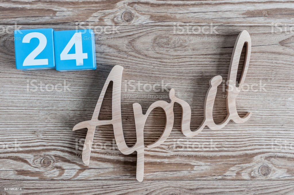 April 24th. Day 24 of month, daily calendar on wooden table background. Spring time theme stock photo