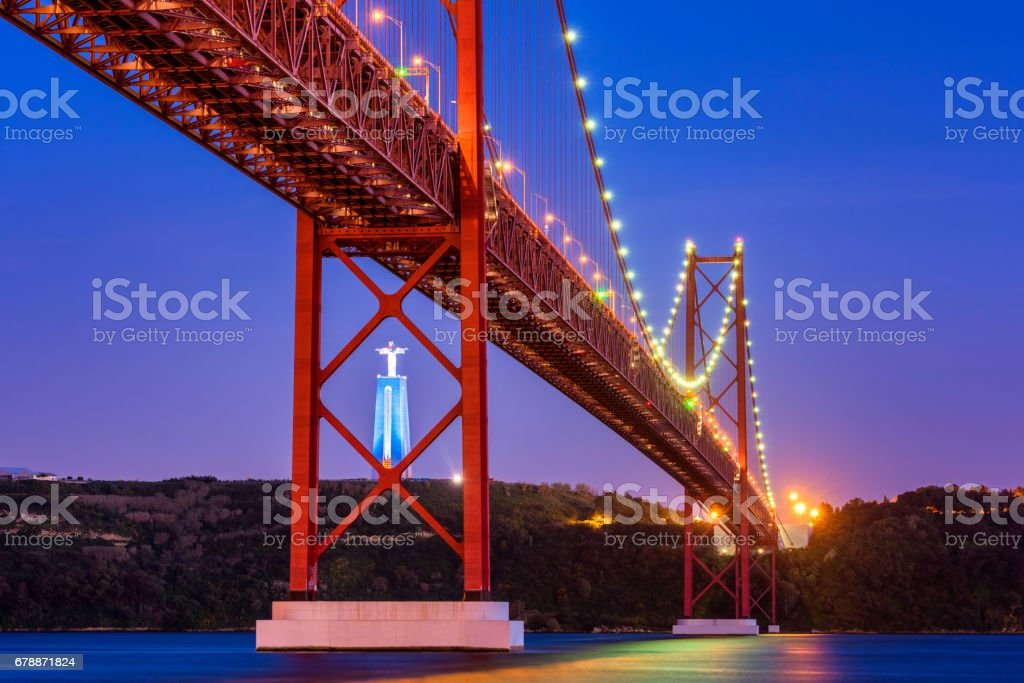 April 25th Bridge and Christ the King statue in Lisbon Portugal at Sunset stock photo
