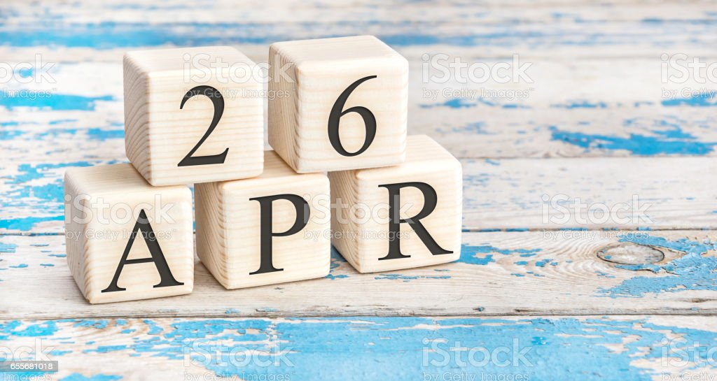 April 26th. Wooden cubes with date of 26 April  on old blue wooden background. stock photo