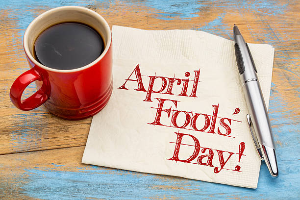 April Fools Day - napkin handwriting April Fools' Day! Handwriting on a napkin with a cup of coffee april fools day stock pictures, royalty-free photos & images
