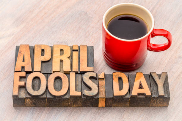April Fools Day word abstract in wood type April Fools'  Day word abstract in vintage lettepress wood type with a cup of coffee april fools day stock pictures, royalty-free photos & images