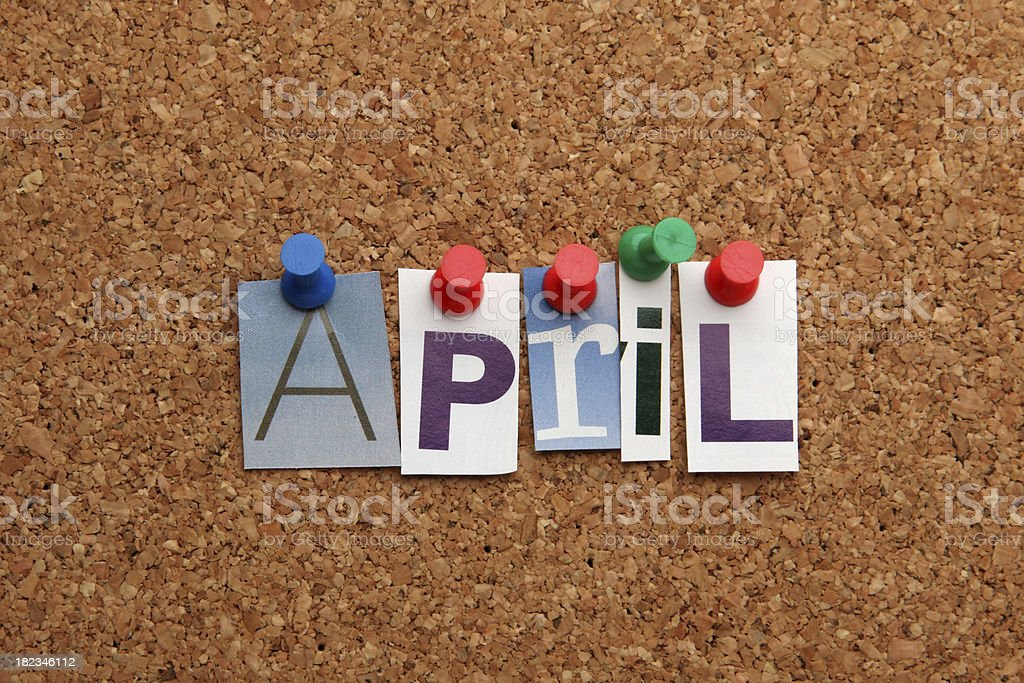 April pinned on noticeboard stock photo