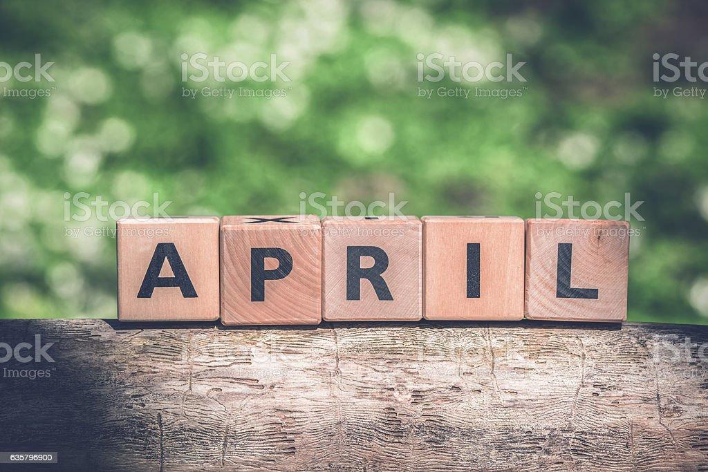 April spring sign in a green garden stock photo