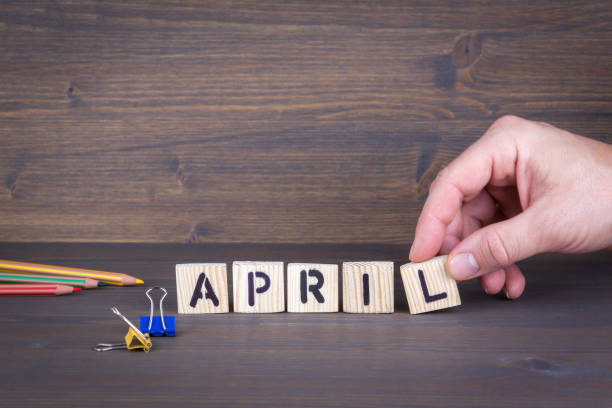 april. wooden letters on the office desk, informative and communication background - welcome march stock photos and pictures