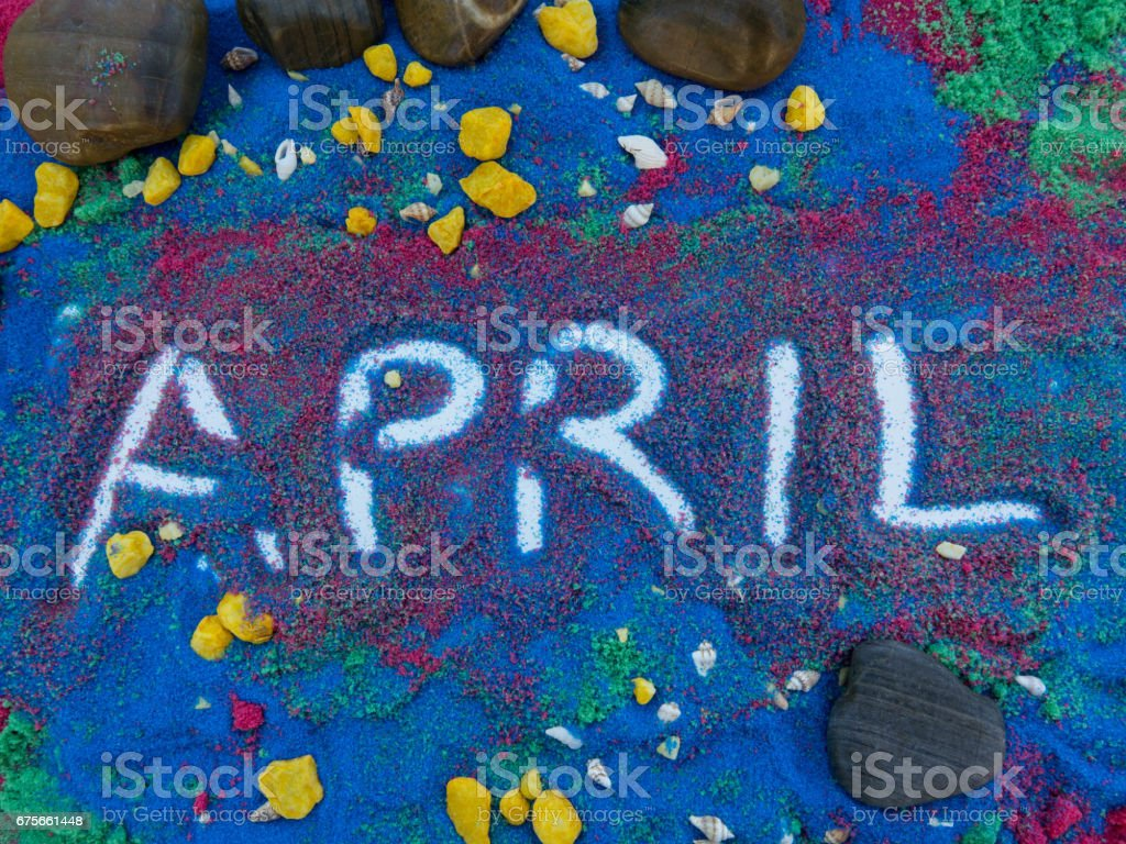 april  written  in colors sand royalty-free stock photo