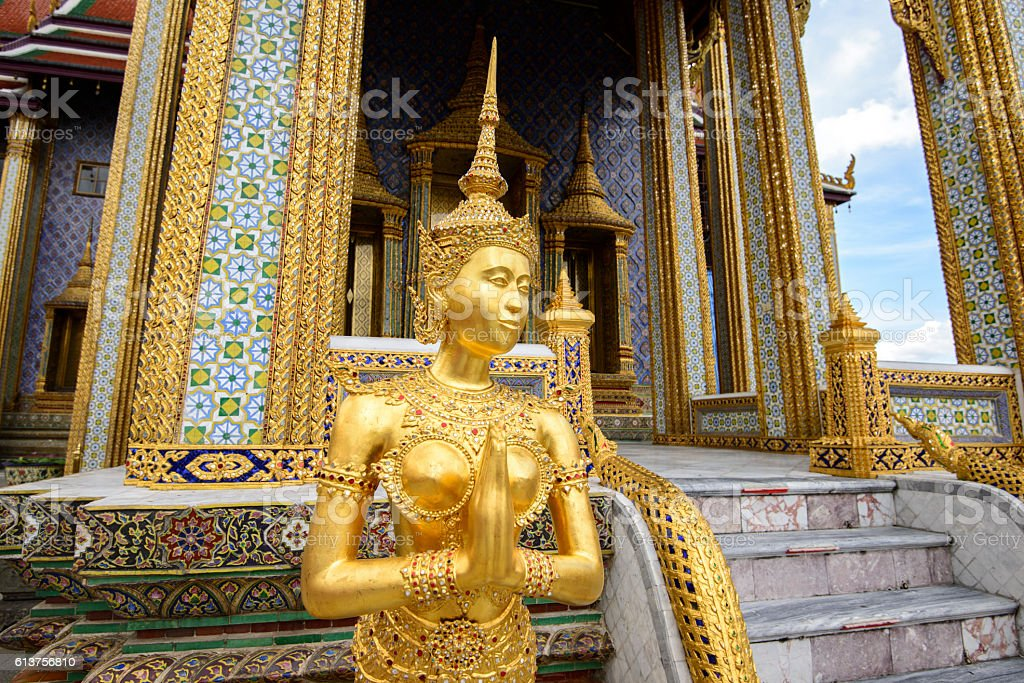 Apsara statue at the Emerald Buddha Temple in Grand Palace stock photo