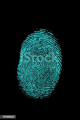 Teal blue fingerprint. Isolated on black background.Other crime and forensics shots: