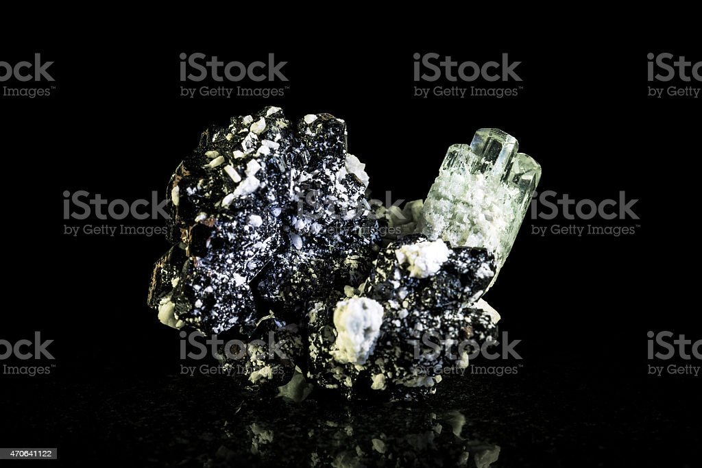 Aquamarine crystal and schorl, black background stock photo