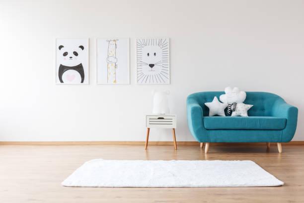 Aquamarine sofa in kid's room stock photo