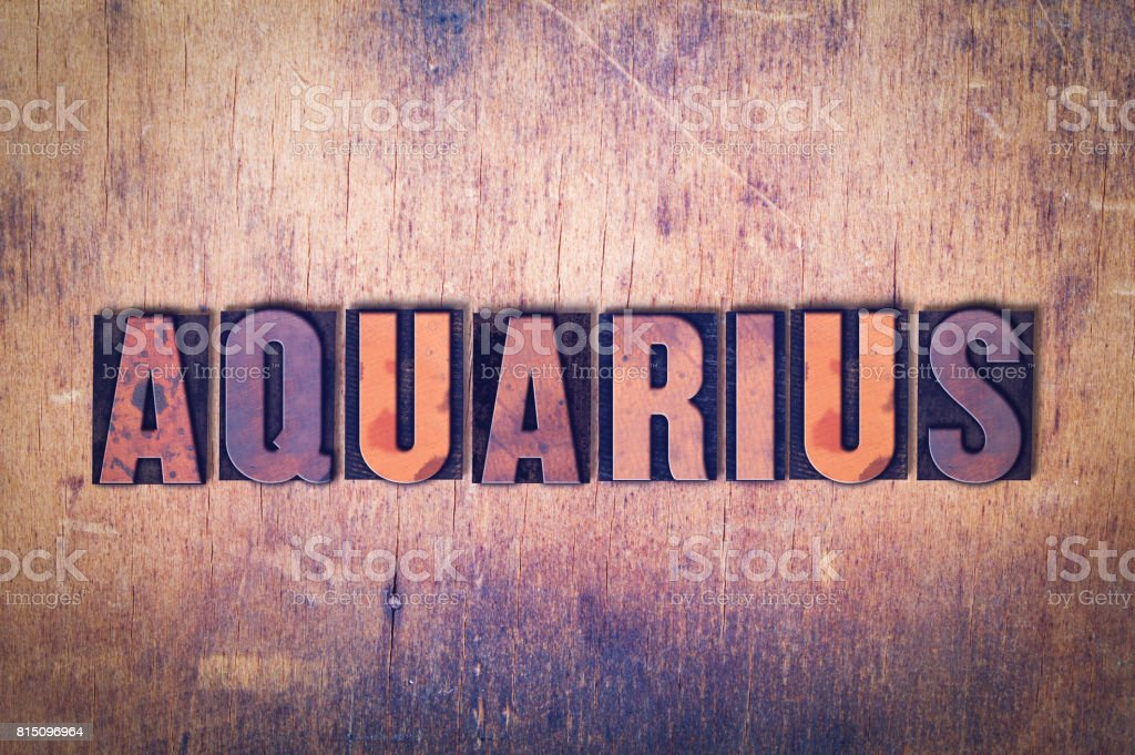 Aquarius Theme Letterpress Word on Wood Background stock photo