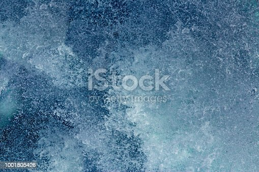 istock Aquatic background of sea surf waves close up with clear water and white foam 1001805426